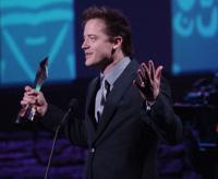 F_fraser_speaking_with_award7_fs
